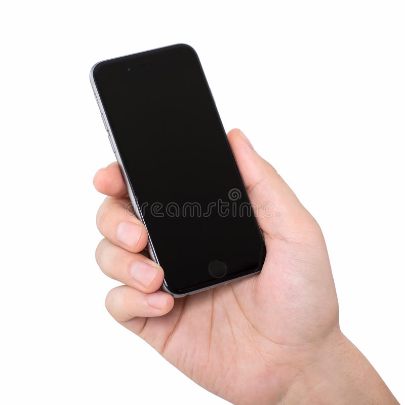 Sirva gris aislado tenencia del espacio del iPhone 6 del teléfono de la mano el nuevo foto de archivo