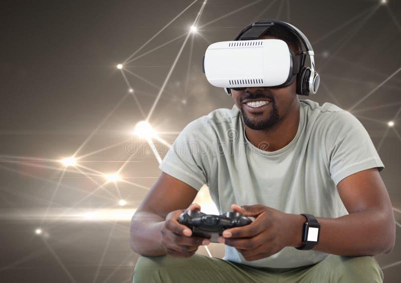 sirva jugar con el regulador del juego de ordenador y las auriculares de la realidad virtual fotos de archivo libres de regalías