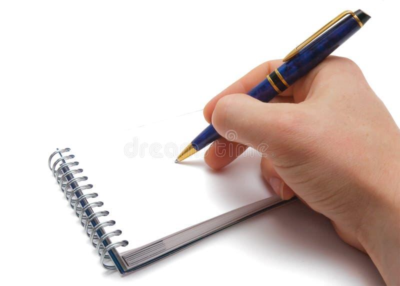 Sirva la mano, la pluma y el cuaderno con space.jpg vacío imagen de archivo libre de regalías