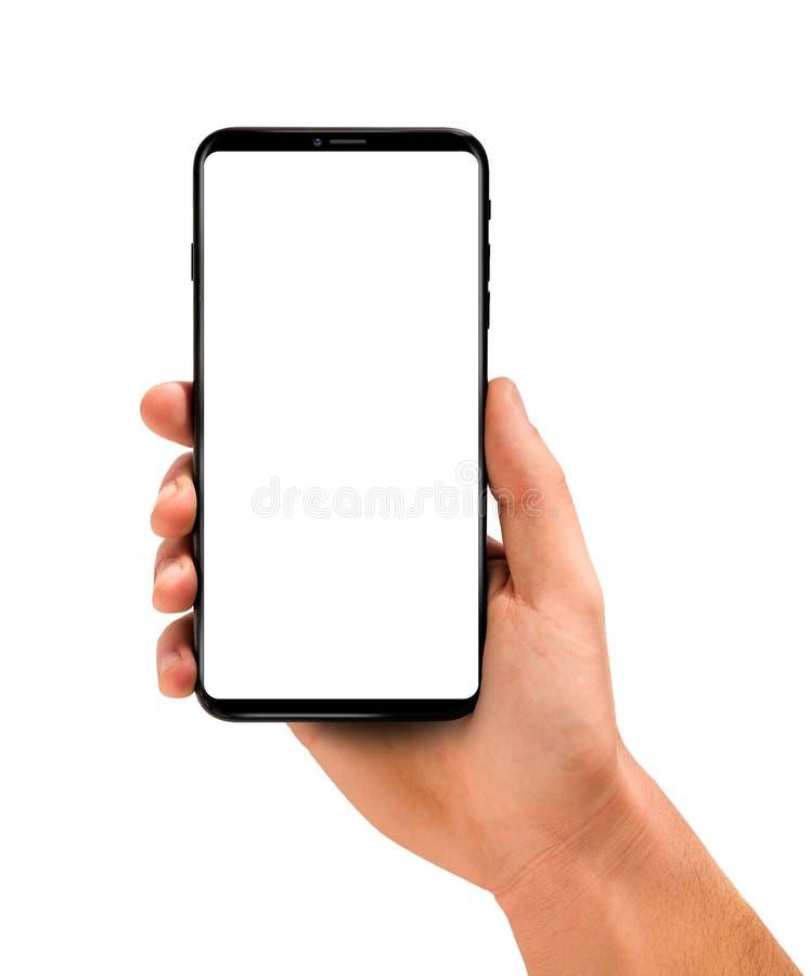 Sirva la mano que sostiene el smartphone negro con la pantalla en blanco imagenes de archivo
