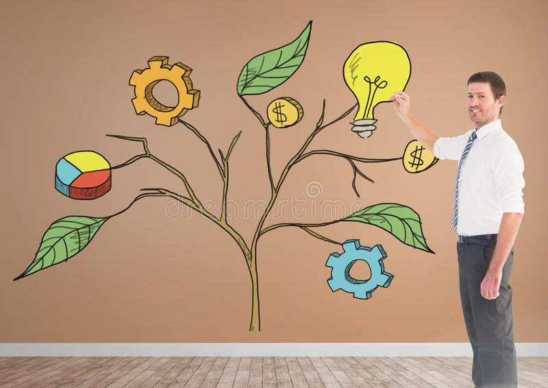 Sirva la pluma de tenencia y el dibujo de los gráficos de negocio en ramas de la planta en la pared imágenes de archivo libres de regalías