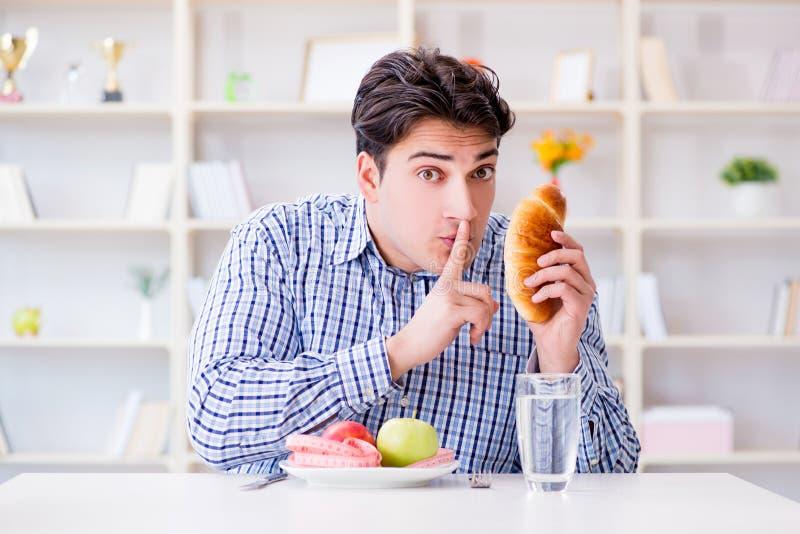 Sirva tener dilema entre la comida y el pan sanos en estafa de dieta fotos de archivo libres de regalías