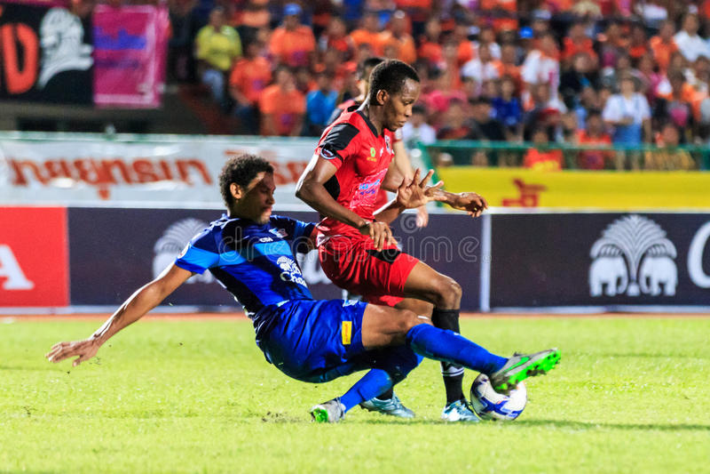 SISAKET THAILAND-AUGUST 12: Adefolarin Durosinmi of Sisaket FC. (crimson) in action during Chang FA Cup between Sisaket FC and Chonburi FC at Sri Nakhon stock images
