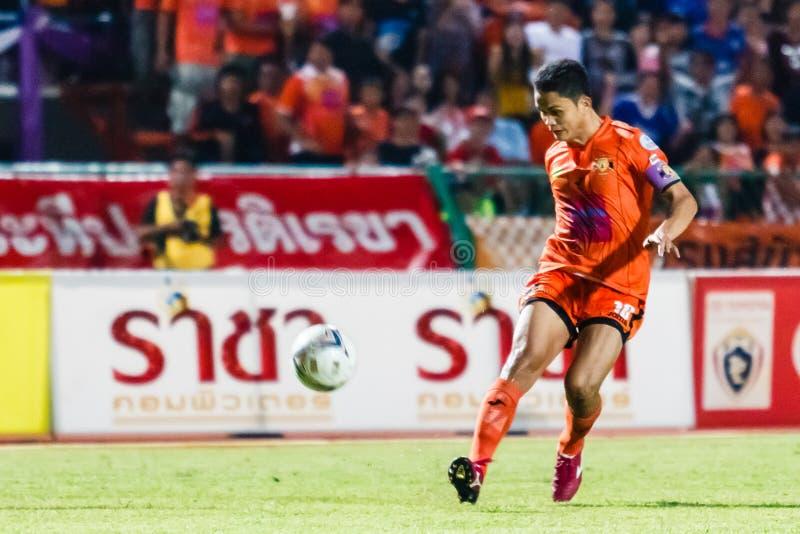 SISAKET THAILAND-AUGUST 3: Sarayuth Chaikamdee of Sisaket FC. (orange) shooting ball during Thai Premier League between Sisaket FC and BEC Tero Sasana FC at stock image