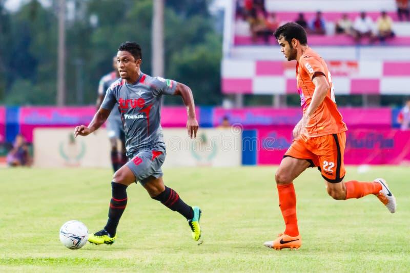 SISAKET THAILAND-JUNE 29: Leandro Tatu of Bangkok Utd. (grey). In action during Thai Premier League between Sisaket FC and Bangkok Utd at Sri Nakhon Lamduan royalty free stock photos