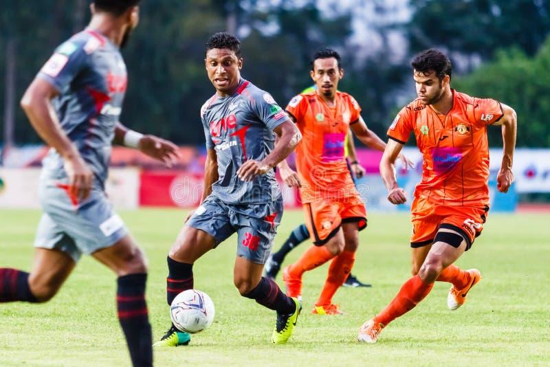 SISAKET THAILAND-JUNE 29: Leandro Tatu of Bangkok Utd. (grey). In action during Thai Premier League between Sisaket FC and Bangkok Utd at Sri Nakhon Lamduan stock photo