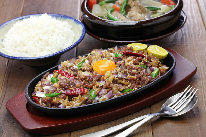 Sisig and sinigang, filipino cuisine stock images