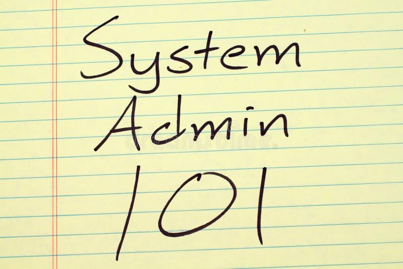 Sistema Admin 101 en un cojín legal amarillo foto de archivo libre de regalías