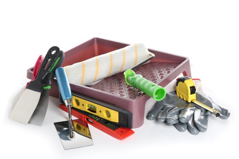 Sistema con las herramientas de pintura en el fondo blanco foto de archivo