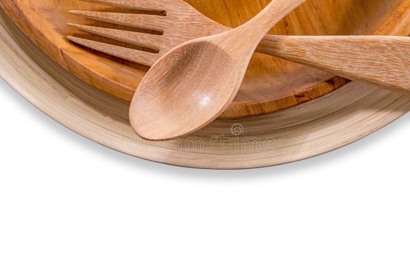 Sistema de bifurcación, de cuchara y de madera del plato aislada sobre blanco fotos de archivo libres de regalías