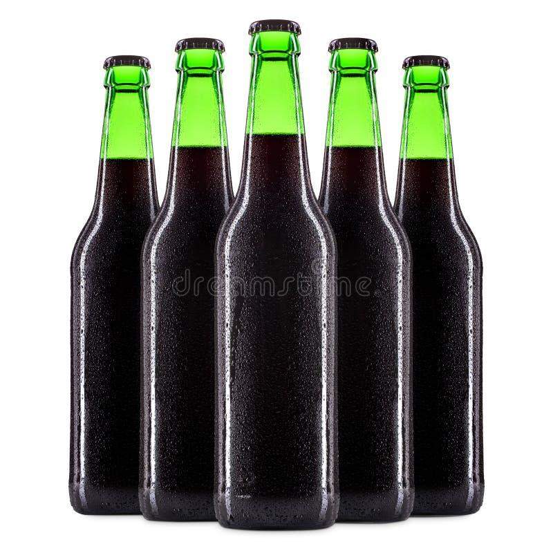 Sistema de botellas de cerveza en blanco fotografía de archivo libre de regalías