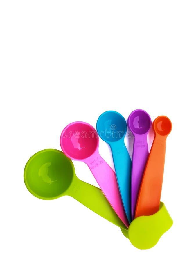 Sistema de cucharas dosificadoras plásticas coloridas fotos de archivo