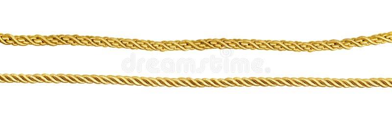 Sistema de cuerdas de seda de oro imagen de archivo