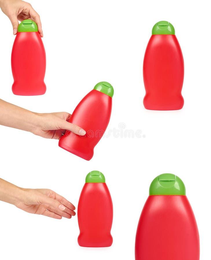 sistema de diversa botella plástica para el champú o de jabón líquido con la mano, aislado en el fondo blanco Hydiene e idea de l foto de archivo libre de regalías