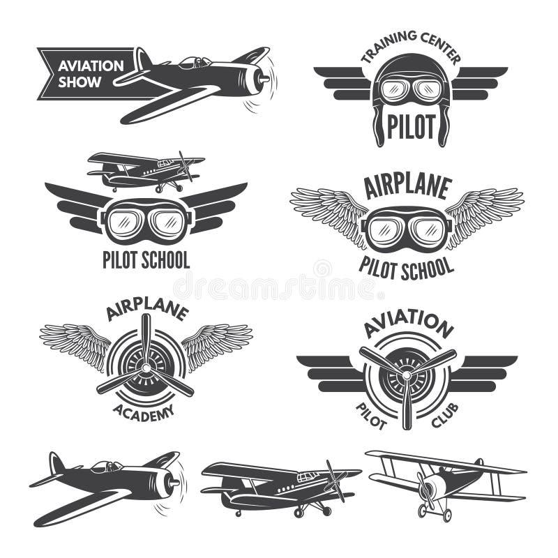 Sistema de etiquetas con los ejemplos de los aeroplanos del vintage Imágenes y logotipo del viaje para los aviadores stock de ilustración