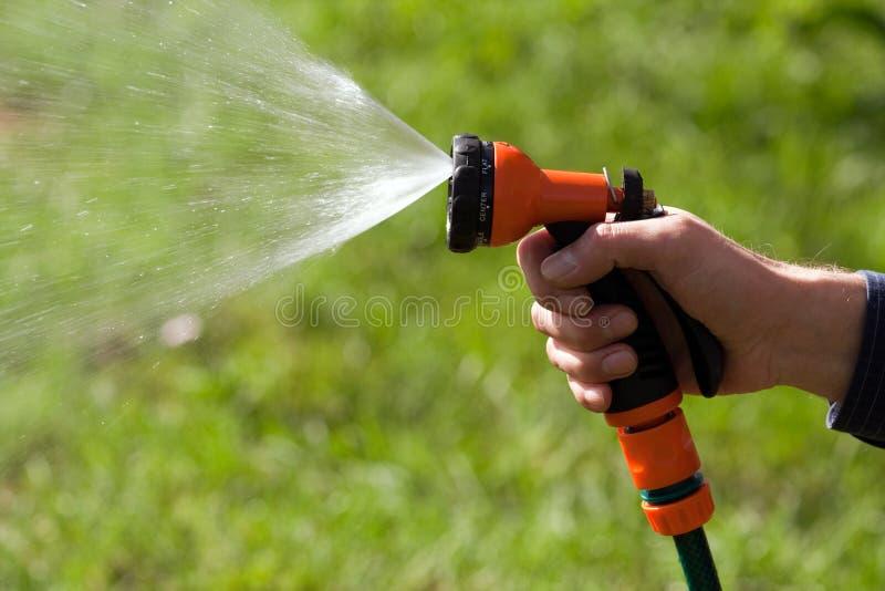 Sistema de extinção de incêndios da água no sol fotografia de stock royalty free