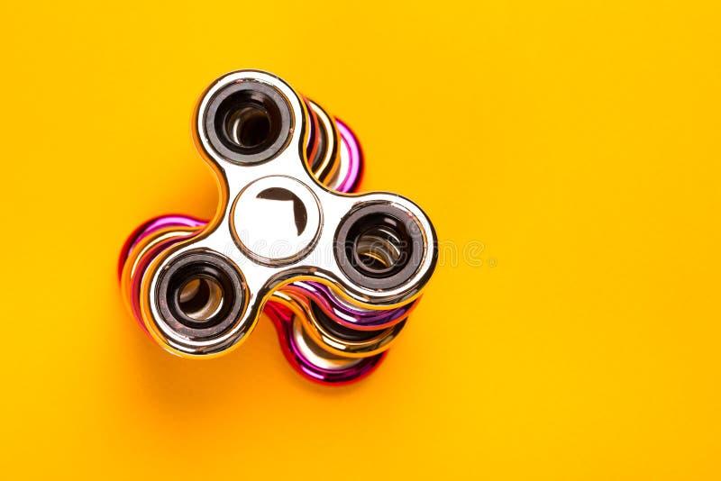 Sistema de hilanderos multicolores de la persona agitada fotos de archivo libres de regalías
