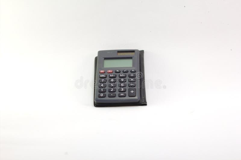 Sistema de iluminação portátil velho da calculadora no Blackground branco fotos de stock
