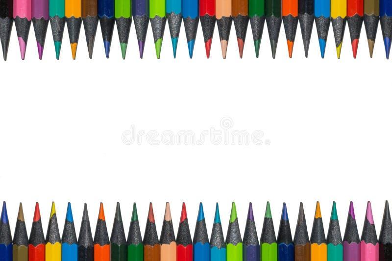 Sistema de lápices coloreados de la madera del ébano, aislado fotografía de archivo