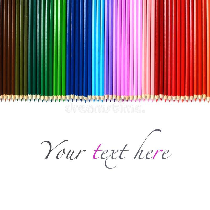 Sistema de lápices de madera multicolores aislados en blanco imagenes de archivo