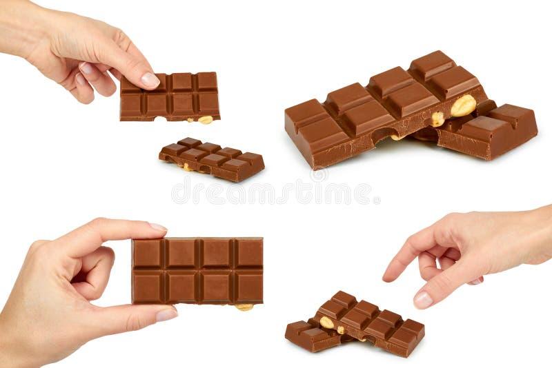 Sistema de la barra del chocolate con leche con la avellana, mano de la mujer Aislado en el fondo blanco Chocolate hecho a mano fotografía de archivo libre de regalías