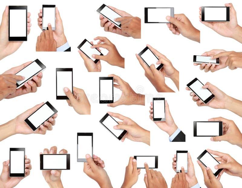 Sistema de la mano que sostiene el teléfono elegante móvil con la pantalla en blanco fotos de archivo
