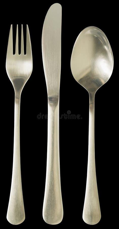 Sistema de la tabla de los cubiertos del cuchillo y de la bifurcación de la cena con la cuchara de sopa aislada en fondo negro imágenes de archivo libres de regalías