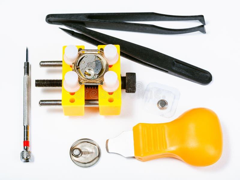 Sistema de las herramientas para substituir la batería en reloj fotos de archivo
