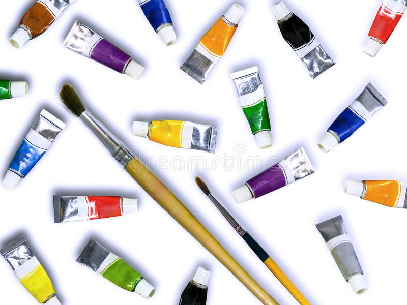 Sistema de las pinturas de la acuarela, cepillos para pintar aislado en blanco imagen de archivo