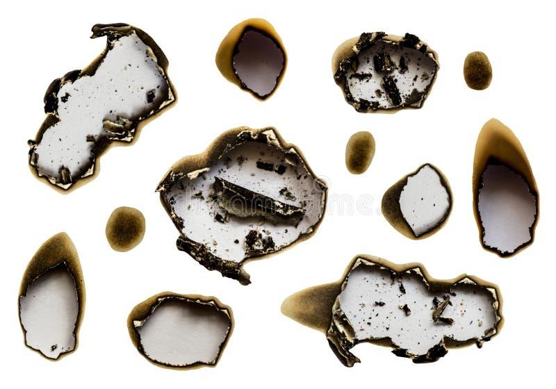Sistema de Libro Blanco chamuscado de los agujeros, aislado en el fondo blanco imágenes de archivo libres de regalías