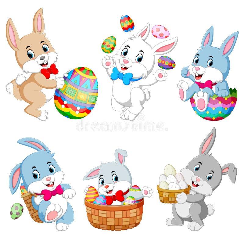 Sistema de los conejos lindos de Pascua con los huevos de Pascua ilustración del vector
