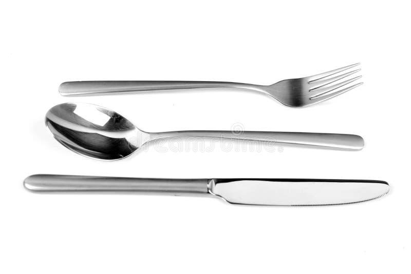 Sistema de los cubiertos Metal la bifurcación y la cuchara con la manija mate en el fondo blanco imágenes de archivo libres de regalías