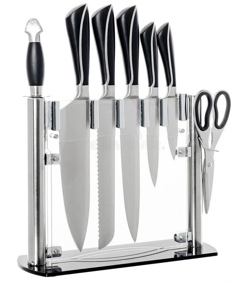 Sistema de los cuchillos de cocina de acero, en el fondo blanco fotografía de archivo