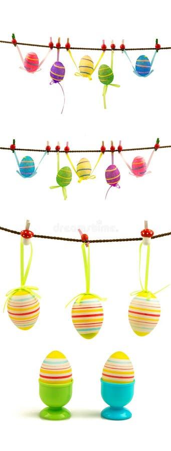 Sistema de los huevos de Pascua coloridos que cuelgan en la cuerda foto de archivo libre de regalías