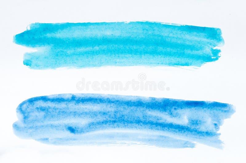 Sistema de movimientos del cepillo de la acuarela de la pintura azul y azul en blanco foto de archivo libre de regalías