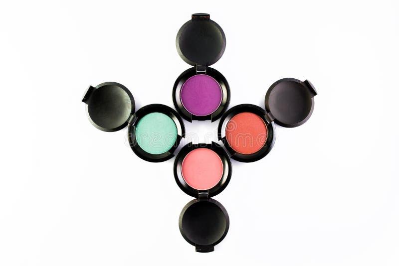 Sistema de 4 sombras de ojos coloridas del maquillaje aisladas en un fondo blanco fotografía de archivo libre de regalías