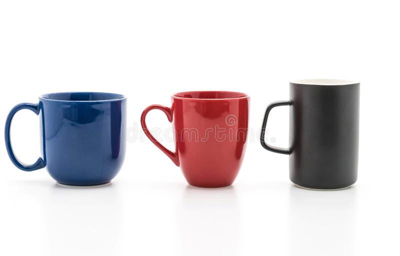 Sistema de tazas negras, rojas y azules en blanco foto de archivo