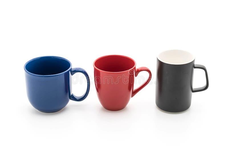 Sistema de tazas negras, rojas y azules en blanco fotos de archivo libres de regalías