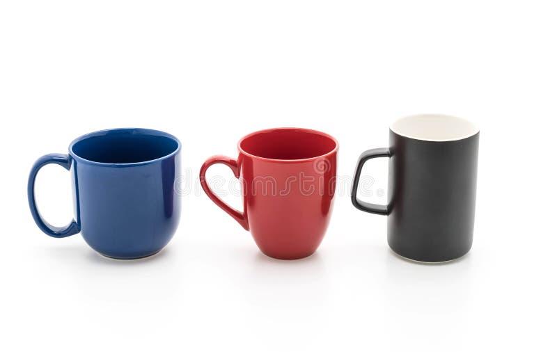 Sistema de tazas negras, rojas y azules en blanco foto de archivo libre de regalías