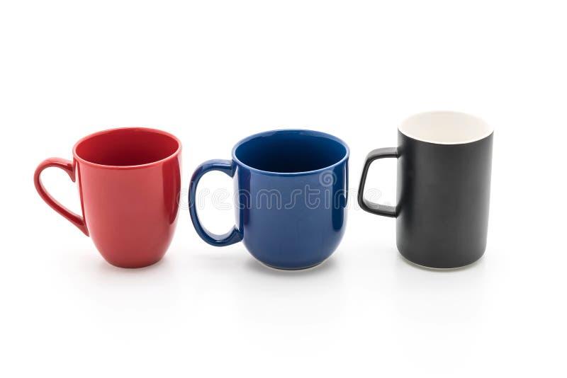 Sistema de tazas negras, rojas y azules en blanco fotografía de archivo libre de regalías