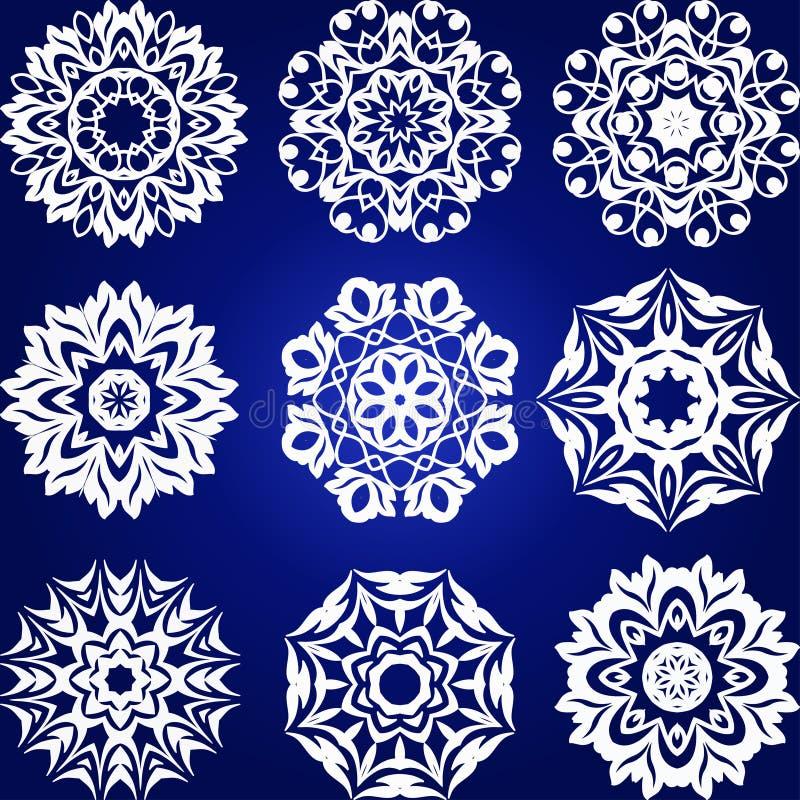 Sistema decorativo del vector de los copos de nieve libre illustration