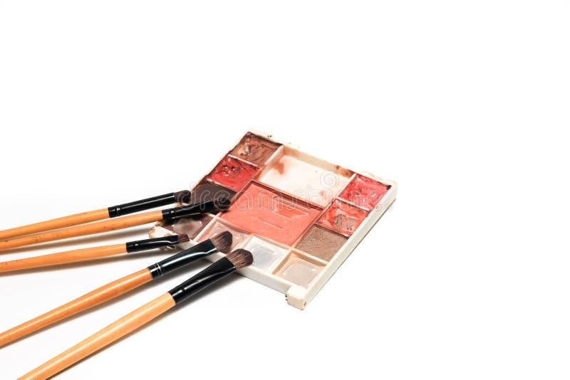 Sistema del cepillo y de la paleta de colores del maquillaje fotografía de archivo