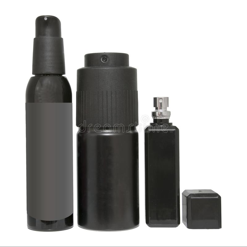 Sistema negro del espray de aerosol Botellas aisladas de primer del desodorante o del perfume foto de archivo