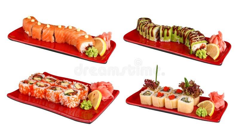 Sistemas de rollos de sushi en placas rojas fotos de archivo libres de regalías