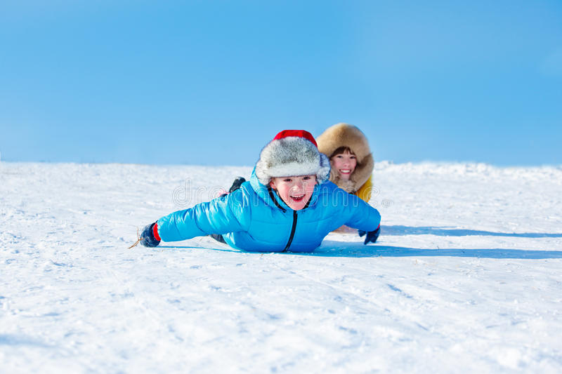 Sister and brother sliding down royalty free stock photography