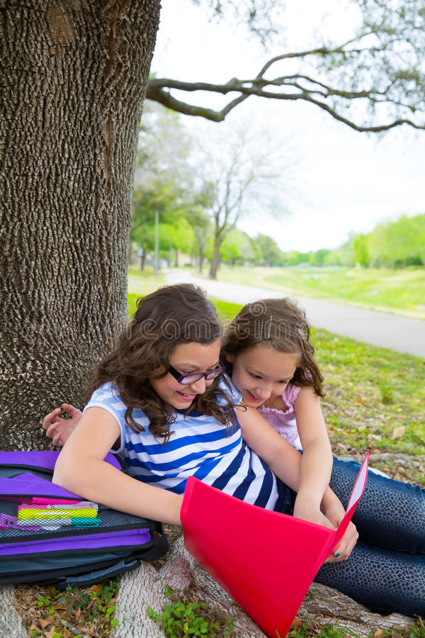 Sister Firends Girls Relaxed Under Tree Park After School Stock Photography