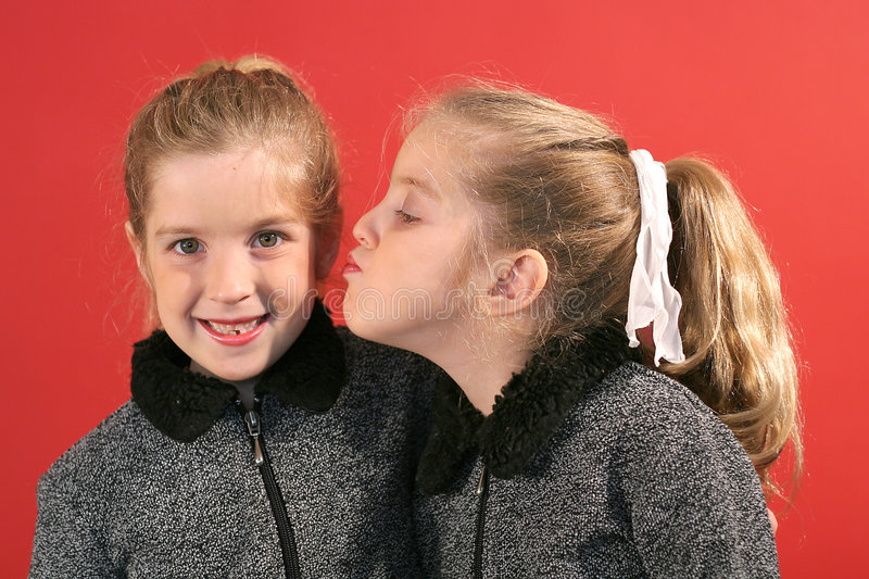 Download Sister giving a kiss stock photo. Image of connection - 2148516
