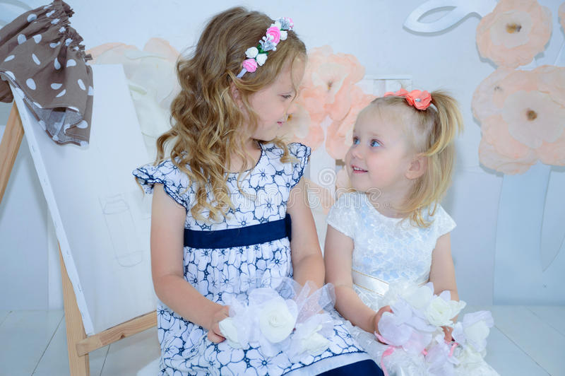Sister having fun in the bad and sharing moments of love. stock image