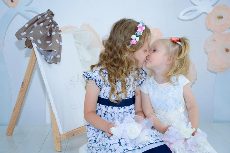 Sister having fun in the bad and sharing moments of love. stock photos