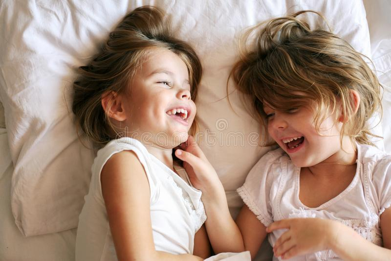 Sisters sharing moments of love. royalty free stock image
